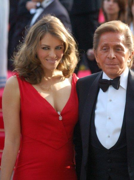 Valentino with actress Liz Hurley