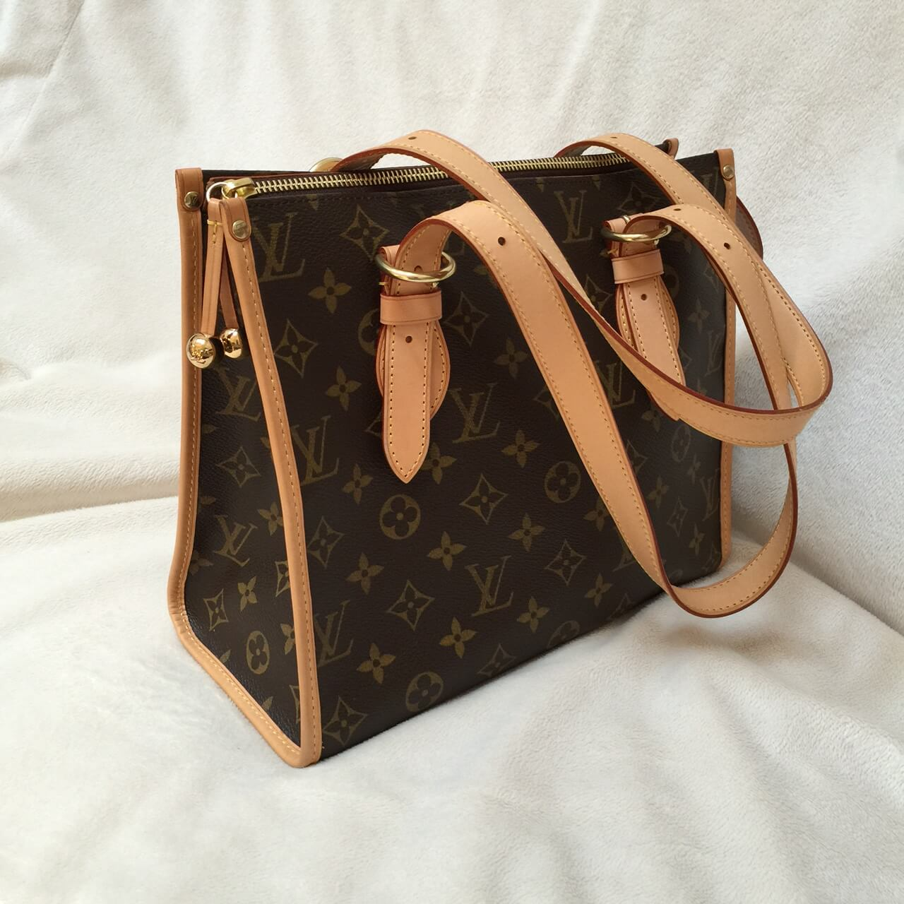 a87e26ca800f How to Repair a Damaged Louis Vuitton Bag
